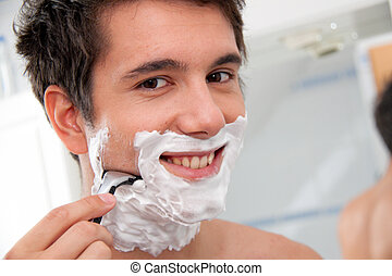 Man shaves with a razor blade And Rasierschau - Young man...