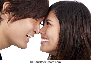 Young asian couple face to face and smiling