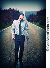 long way to walk - young businessman with crutch and long...