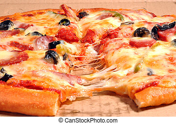 Pizza - Close-up of hot and fresh Supreme Pizza in the...