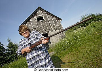 Woman with huge rifle - Photo of an older woman holding a...