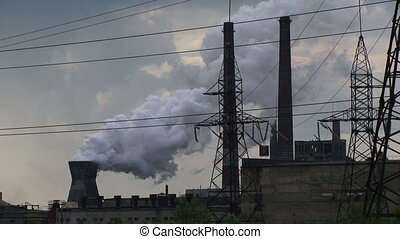 Toxic emissions - Factory pollutes the environment large...