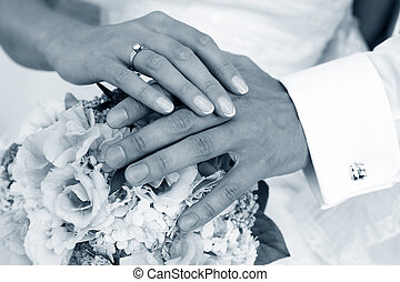 Wedding ring - Hand of the groom and the bride with wedding...