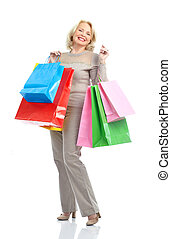 Shopping woman - Shopping happy elderly woman. Isolated over...