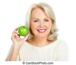 woman with a green apple - Mature smiling woman with a green...