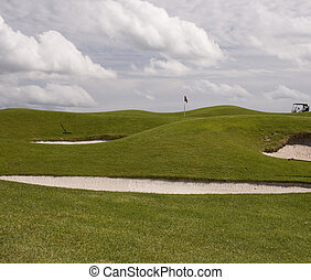 Sand Traps - Sand traps protect the green at the golf course