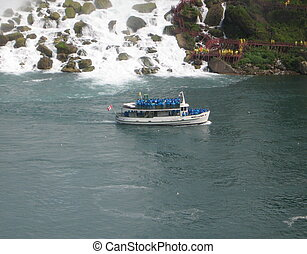 Maid of the Mist - With the American Falls behind it, one of...