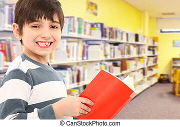 Student with Book in School Library - Attractive 7 year old...