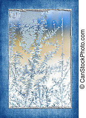 Ice Crystals - Ice crystal pattern on windowpane with blue...