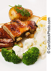 Barbecued ribs with cauliflower and broccoli - Barbecued...