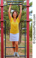 Woman in the park - Woman preparing to exercise in a park