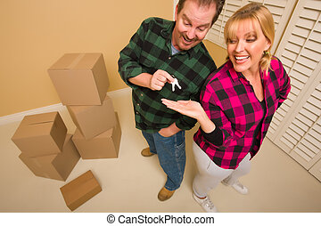 Goofy Excited Man Handing Keys to Smiling Wife