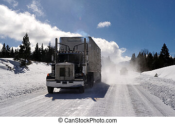 Semi-trailer Tuck On Icy Road - Big Rig and trailer driving...