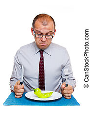 Businessman on a diet - Businessman eating one green pepper...