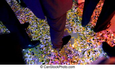 dancing feet of men at party