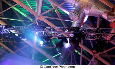 lighting equipment at concert - colored spotlights on...