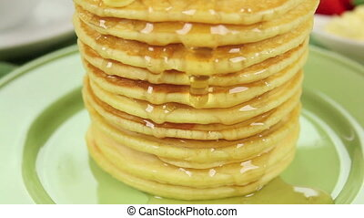Dripping Pancake Stack - Honey dripping down the face of a...
