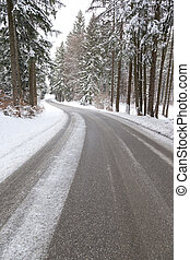 snowy road - An image of a deep winter snowy road