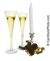 White Christmas candle and ornaments, with two champagne...