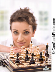 Young businesswoman playing chess