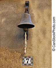 Old fashioned bell as doorbell