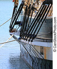 Rigging - rigging of a sail boat with the blue water in the...