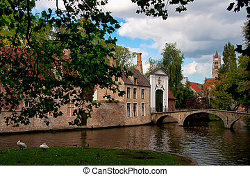 Bruges Beguinage. - View from under trees upon Bruges...