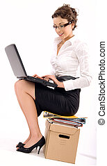 Successful young businesswoman sitting on pile of documents,...
