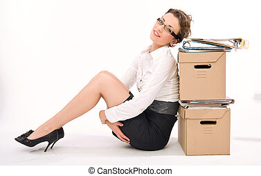 Young attractive businesswoman next to pile of documents,...