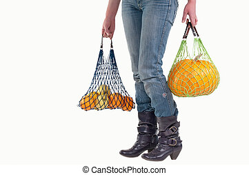 Waist down view of woman with groceries - Woman with...
