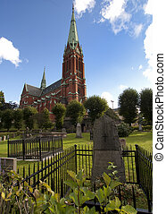 Cemetery at Saint Johannes Churh. - Red brick church...