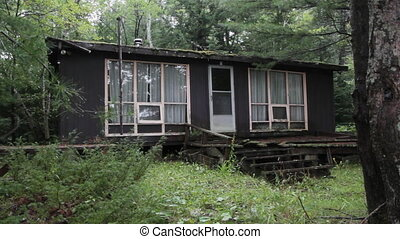 Abandoned cottage. Three shots. - An abandoned cottage in...