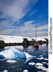 yacht in Antarctica - yacht sailing among the glaciers in...