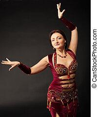 mature woman dance in arabic costume