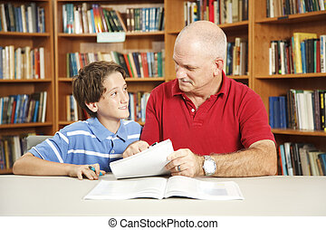 Tutoring From Dad - Father or male teacher tutoring a young...
