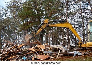 House Demolition - Excavator demolition activity on an old...