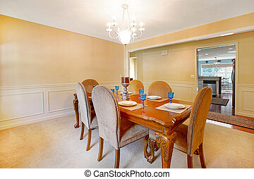 Dining room with antique table and yellow walls