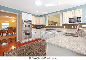 White kitchen with cheryy hardwood