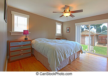 Brown bedroom with blue bedding