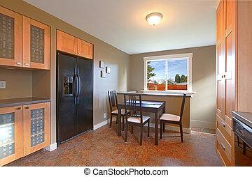 Modern maple kitchen with black appliances