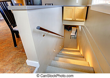Staircase to the basement with lights on
