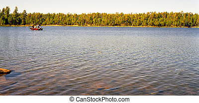 Boaters Fishing - Boaters fishing on a forest lake