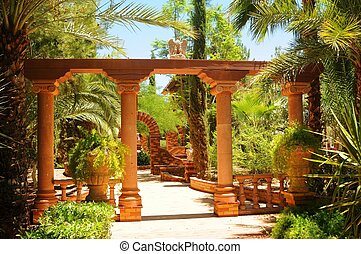 Garden Trail - Garden trail with arches and palm trees
