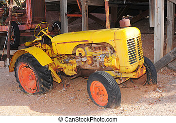 Old Yellow Tractor - Old broken down tractor with flat tires