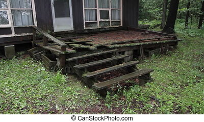 Old cottage porch. Two shots. - An old and broken porch on...