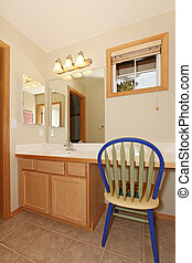 Small bathroom with sink and chair