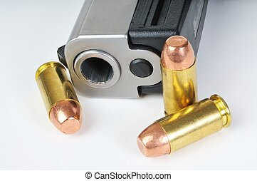 Close up isolated image of 40 caliber pistol with bullets