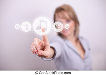 Woman pressing music button with one hand