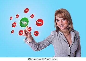 hand pressing Start button
