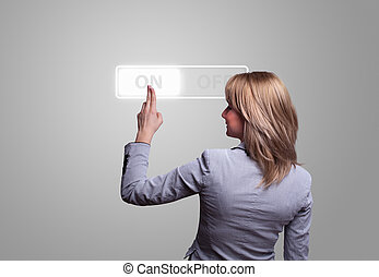 woman hand pressing ON button